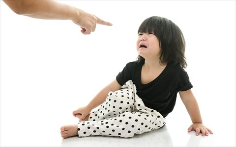 Asian baby crying while mother scolding on white background isolated